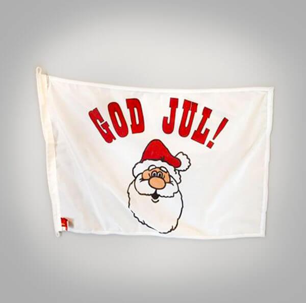 """Flagga med tomte och texten """"god jul""""."""